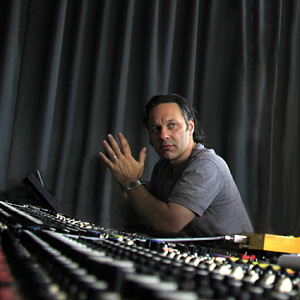 mark wingfield sits by a recording console